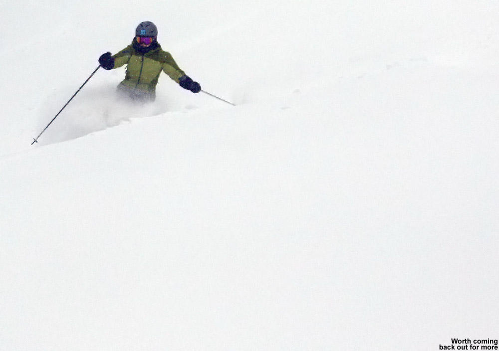 An image of Erica skiing some deep powder on the Tattle Tale Trail at Bolton Valley Ski Resort in Vermont