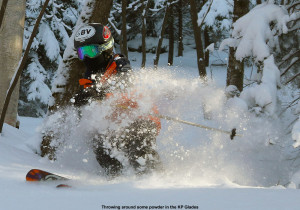 An image of Ty spraying some powder snow in the KP Glades area of Bolton Valley Ski Resort in Vermont