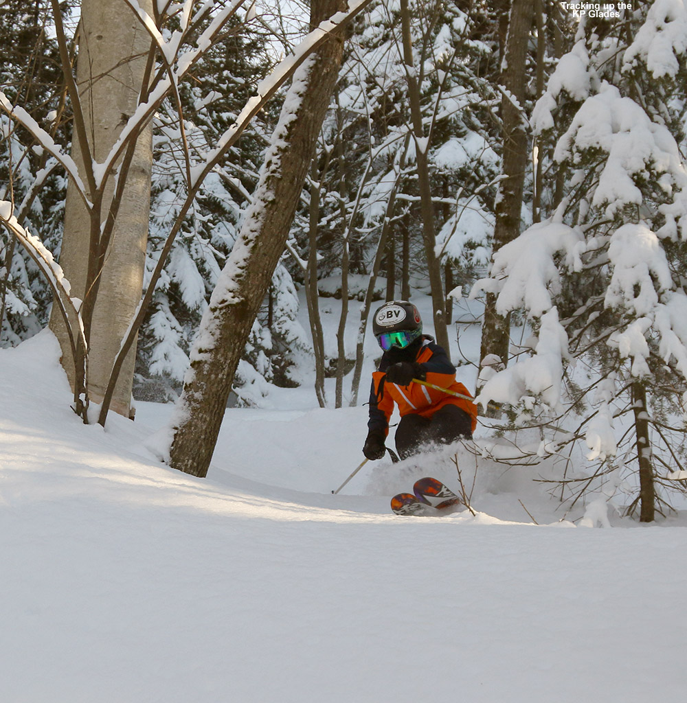 An image of Ty skiing powder snow in the KP Glades area of Bolton Valley Ski Resort in Vermont