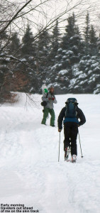 An imae of two hikers ascending the Twice as Nice trail at Bolton Valley Ski Resort in Vermont