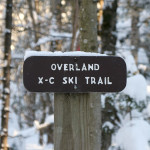 An image of the Overland Cross-Country Ski Trail sign near the Stevensville parking lot outside Underhill Center in the Green Mountains of Vermont