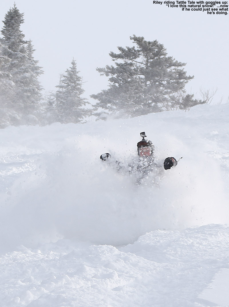 An image of Riley riding his snowboard in deep powder snow on the Tattle Tale trail at Bolton Valley Ski Resort in Vermont