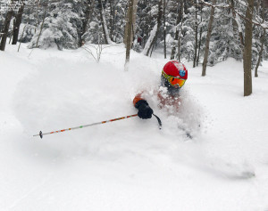 An image of Dylan deep in some champagne powder while skiing at Bolton Valley Resort in Vermont