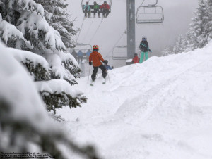 An image of some kids skiing on the Upper National trail at Stowe Mountain Resort in Vermont