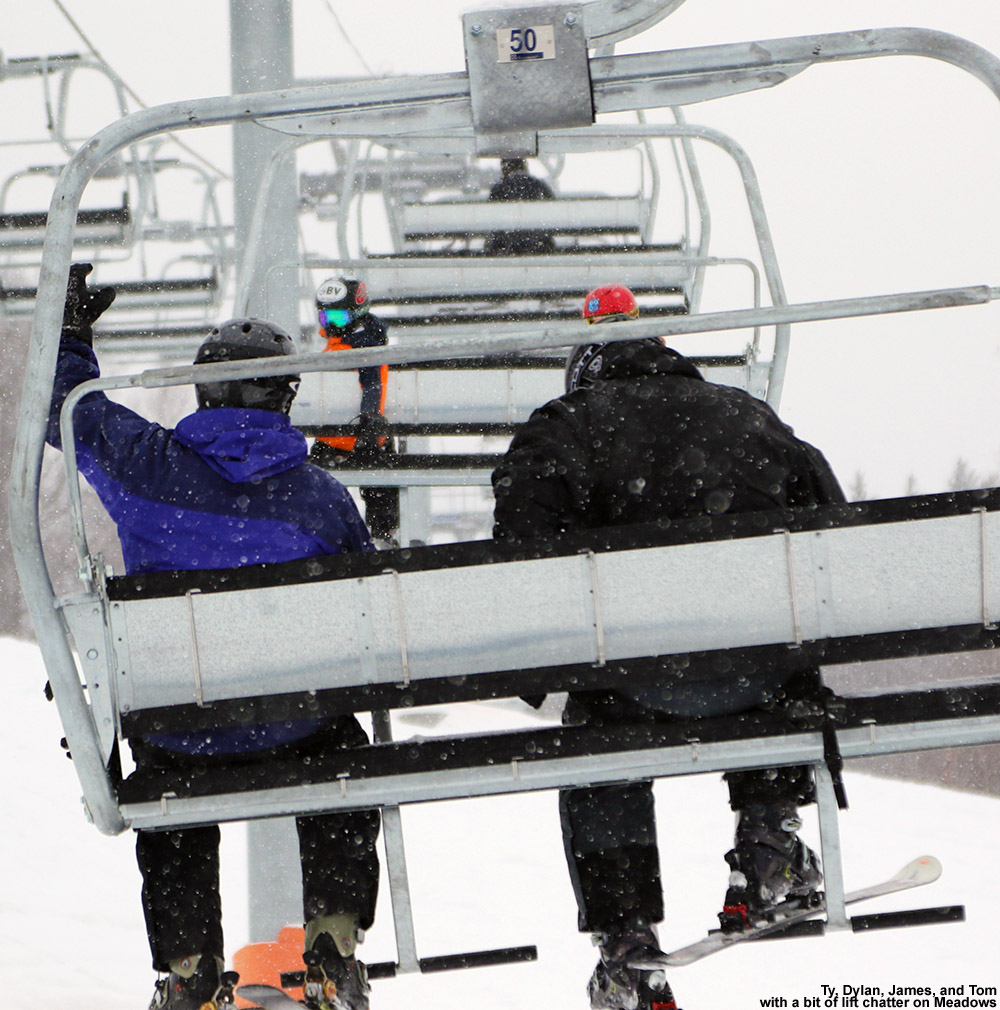 An image of Ty, Dylan, Tom, and James riding the Meadows Quad Chair at Stowe Mountain Ski Resort in Vermont