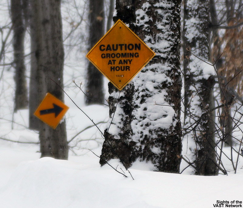 An image showing some trail signs on the VAST snowmobile trail heading from Bolton Valley to Bolton Notch in Vermont