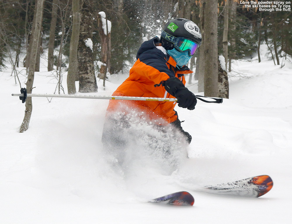 An image of Ty spraying powder with his skis in the KP Glades area of Bolton Valley Ski Resort in Vermont