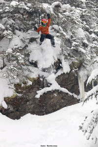 An image of Dylan jumping off a cliff into deep powder at Bolton Valley Ski Resort in Vermont