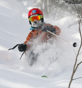 An image of Dylan skiing deep powder in the Hazelton area at Stowe Mountain Resort in Vermont