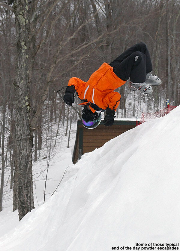 An image of Ty doing a back flip into some powder at the base of Stowe Mountain Ski Resort in Vermont