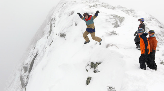 An image of Luc jumping off the ridge line of Mt. Mansfield into some deep powder above Stowe Mountain Resort in Vermont
