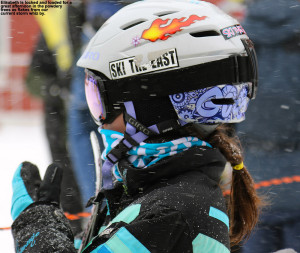 An image of Elisabeth in her ski helmet with snow falling at Stowe Mountain Resort in Vermont