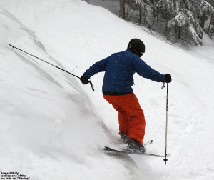 An image of Joe skiing one of the ice falls on the Ravine trail at Stowe Mountain Resort in Vermont