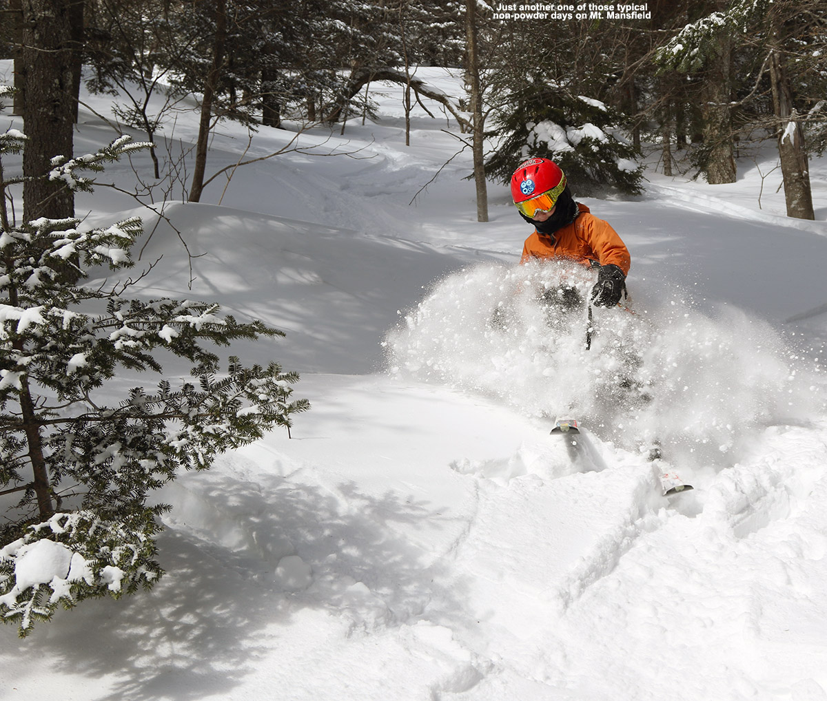 An image of Dylan skiing powder snow out near the Angel Food area of Stowe Mountain Resort in Vermont