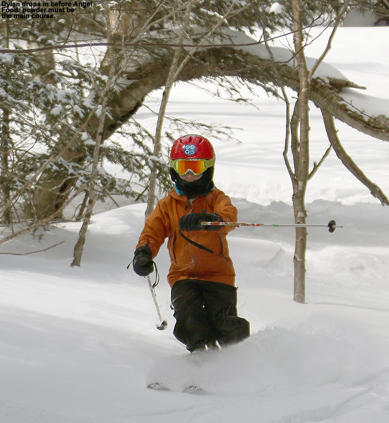 An image of Dylan skiing powder after dropping off the Angel Food traverse near Stowe Mountain Resort in Vermont