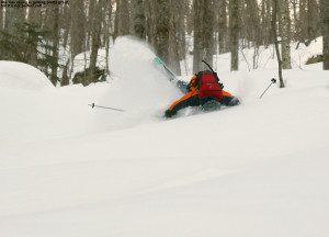 An image of Ty crashing in the powder on a backcountry ski tour in the Lincoln Gap area of Vermont