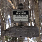 An image of a sign marking the boundary of the Breadloaf Wilderness Area in Vermont