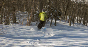An image of Erica skiing a little powder on the Snowflake Bentley trail at Bolton Valley Ski Resort in Vermont