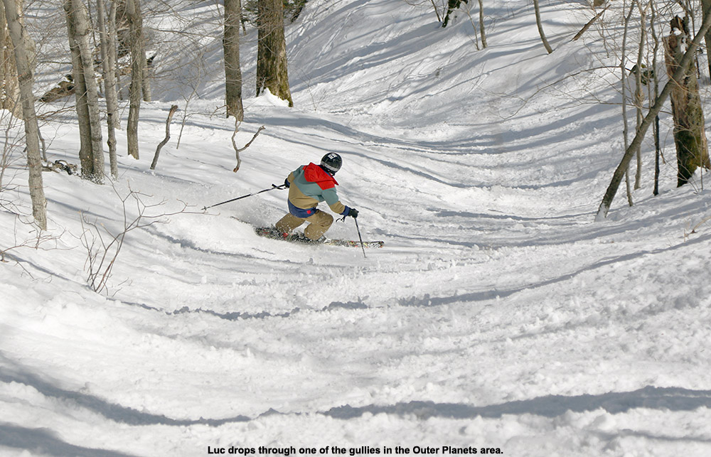 An image of Luc skiing in the Outer Planets area at Stowe Mountain Resort in Vermont