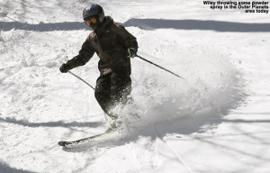 An image of Wiley skiing some powder in the Outer Planets area outside of Stowe Mountain Resort in Vermont