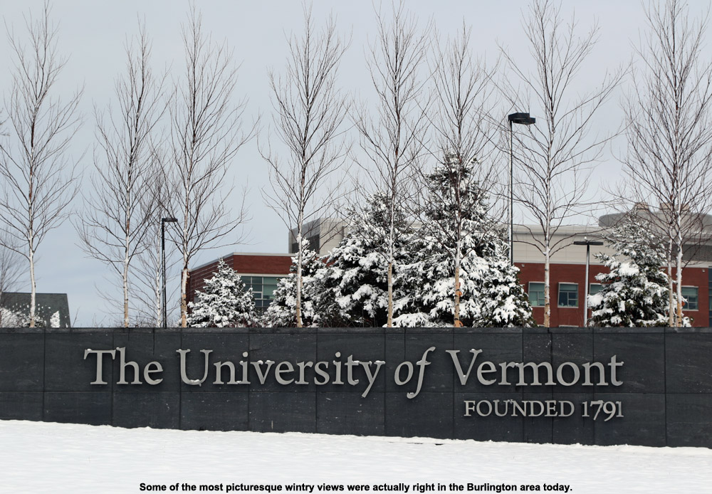An image of a sign for the University of Vermont with a coating of fresh snow
