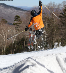 An image of Ty doing a jump on skis at Stowe Mountain Resort in Vermont