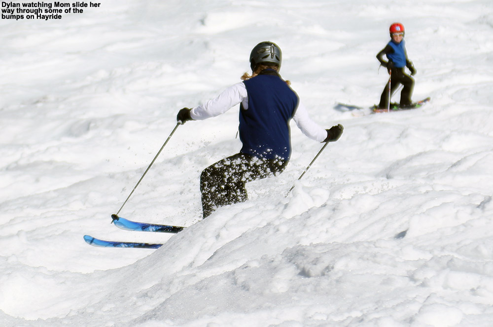 An image of Erica skiing moguls in soft spring snow at Stowe Mountain Resort on the Hayride trail