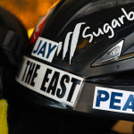 An image of a ski helmet with stickers in the Mansfield Base Lodge at Stowe Mountain Resort in Vermont