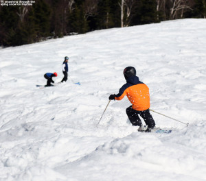 An image of Ty skiing spring moguls on the Hayride trail at Stowe Mountain Resort in Vermont