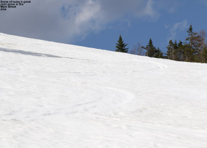 An image of May ski tracks in spring snow on the slopes of Spruce Peak at Stowe Mountain Resort in Vermont