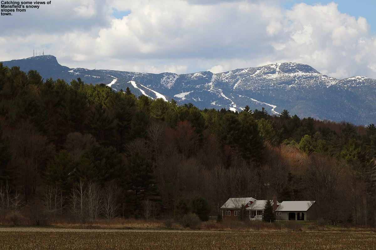 An image of Mt. Mansfield in Vermont in May with snow on the ski slopes