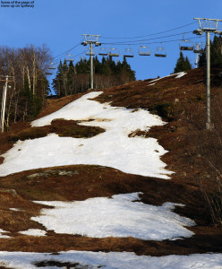 An image showing the remaining snow on the Spillway trail at Bolton Valley Ski Resort in Vermont in early May