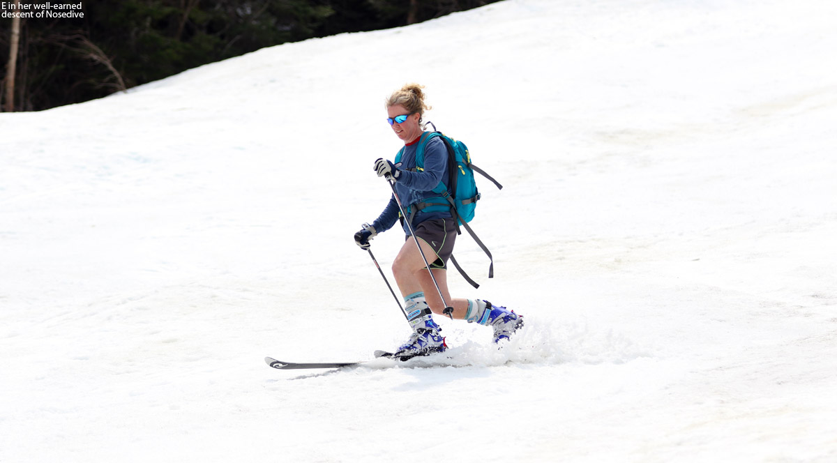 An image of Erica Telemark skiing on the Nosedive trail at Stowe Mountain Resort in Vermont in May