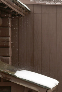 An image of melted snow pouring off the roof of the Mansfield Base Lodge at Stowe Mountain Resort in Vermont