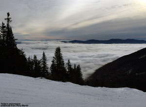 An image showing low clouds with mountains sticking out as viewed from Mt. Mansfield and Stowe Ski Resort in Vermont