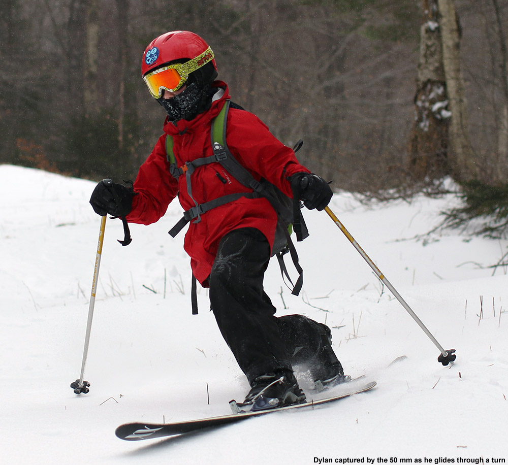 An image of Dylan Telemark skiing on fresh snow at Bolton Valley Ski Resort in Vermont