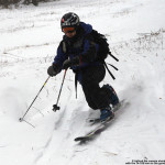 An image of Jay Telemark skiing on some fresh powder from Winter Storm Goliath at Bolton Valley Ski Resort in Vermont