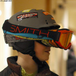 An image of a boy wearing multiple pairs of ski goggles for fun