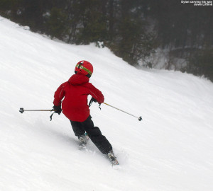 An image of Dylan carving a turn on the Liftline trail at Stowe Mountain Resort in Vermont