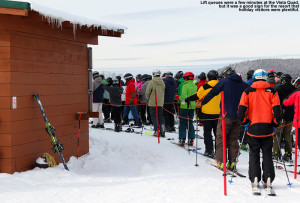 An image of skiers in a lift queue at Bolton Valley Resort in Vermont