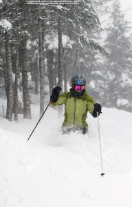 An image of Erica skiing some deep snow in the Nosedive Glades at Stowe Mountain Resort in Vermont