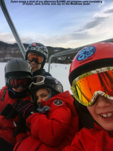 An image of Jay, Jack, Emma, and Dylan on the Meadows Quad Chair at Stowe Mountain Resort in Vermont