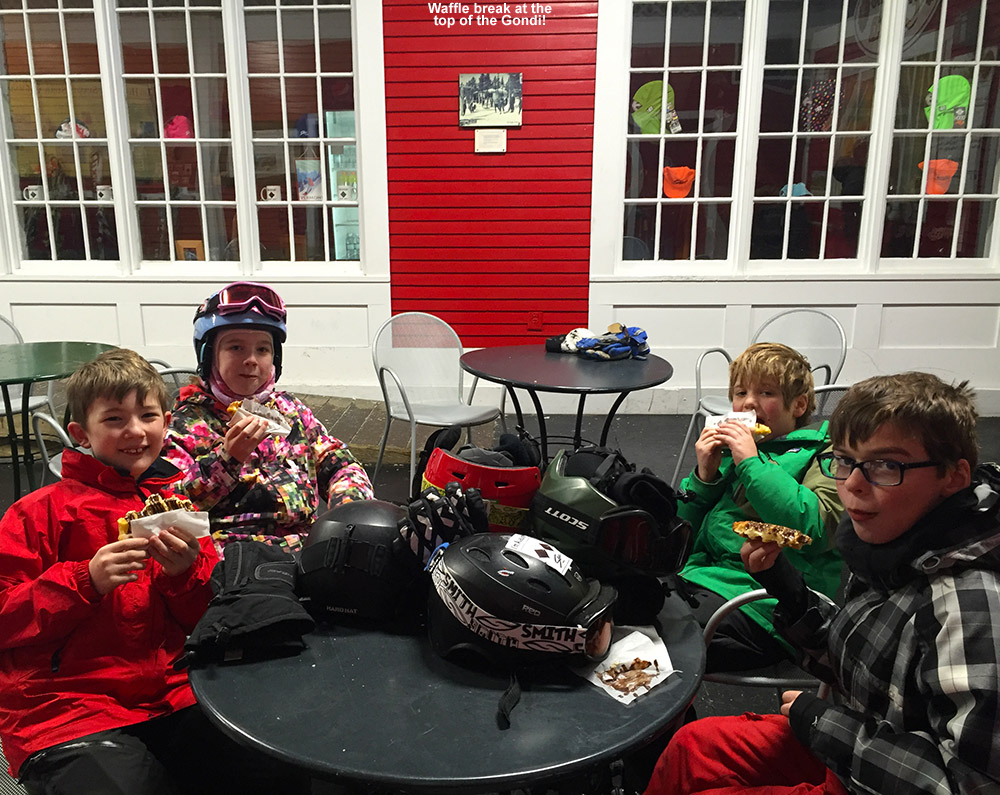 An image of some BJAMS students having chocolate-covered waffles up at the top of the Gondola at Stowe Mountain Resort in Vermont