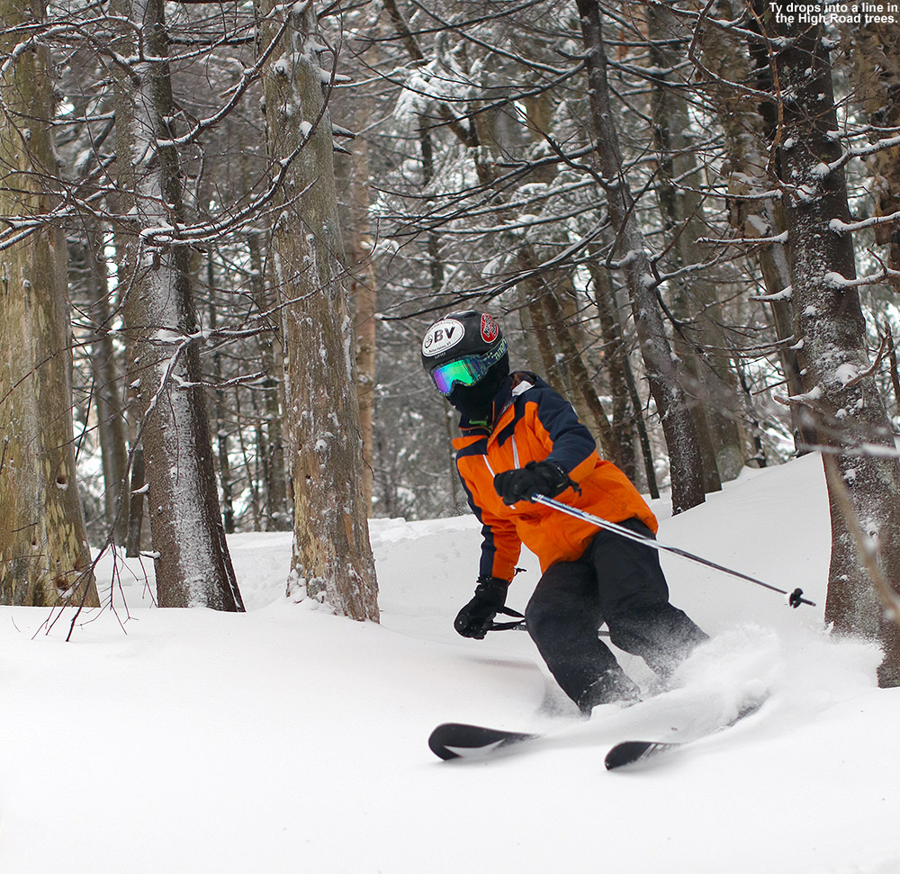 An image of Ty skiing powder snow in the High Road Trees at Stowe Mountain Resort in Vermont