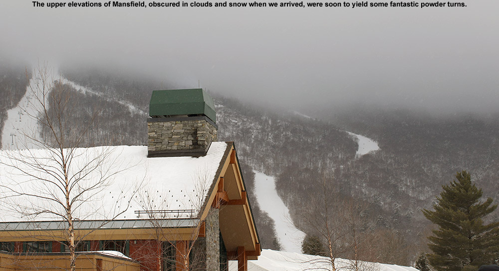 An image of Mt. Mansfied with clouds on the upper mountain at Stowe Mountain Resort in Vermont