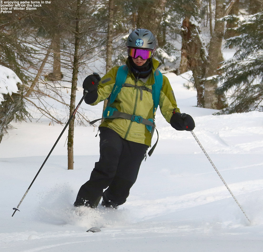 An image of Erica sking powder on the backcountry network at Bolton Valley Ski Resort in Vermont