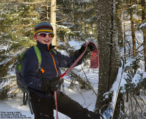An image of Dylan removing his skins from his skis on a backcountry ski outing on the backcountry network at Bolton Valley Ski Resort in Vermont