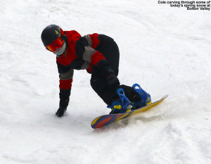 An image of Cole riding his snowboard in soft spring snow at Bolton Valley Ski Resort in Vermont