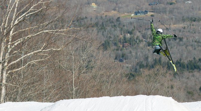 An image of Luke in the air after a jump in the Tyro Terrain Park at Stowe Mountain Resort in Vermont