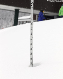 An image showing a depth measurement of a foot of powder at the top of the Gondola at Stowe Mountain Resort in Vermont